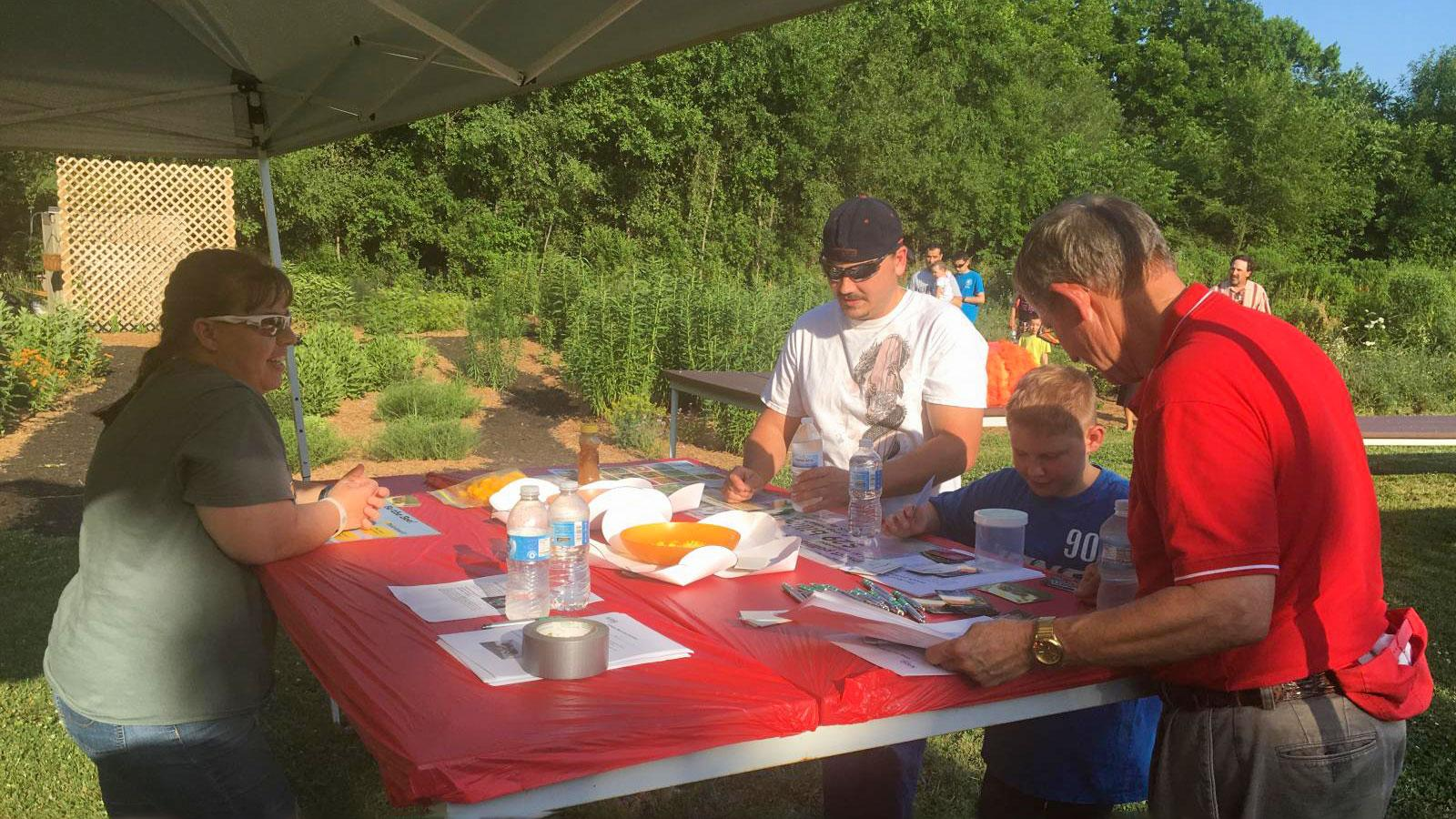 family at an outdoor science literacy event