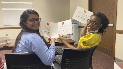 Heena Puri and Blessing Ademokoya with their speech contest award certificates