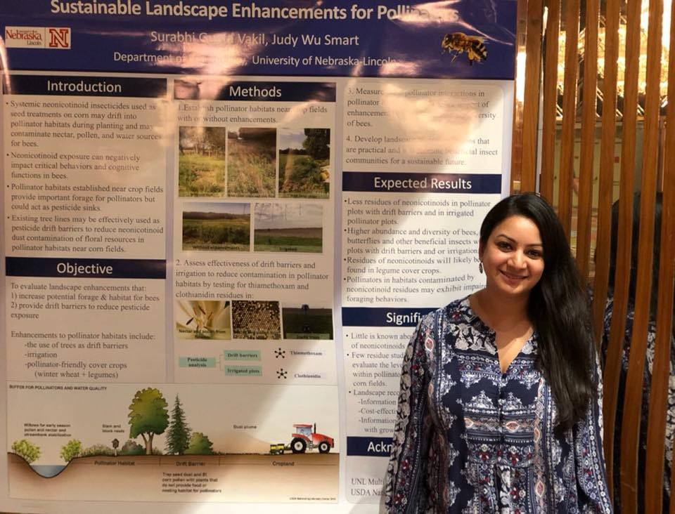 Surabhi Ph.D. student proudly displaying her research poster
